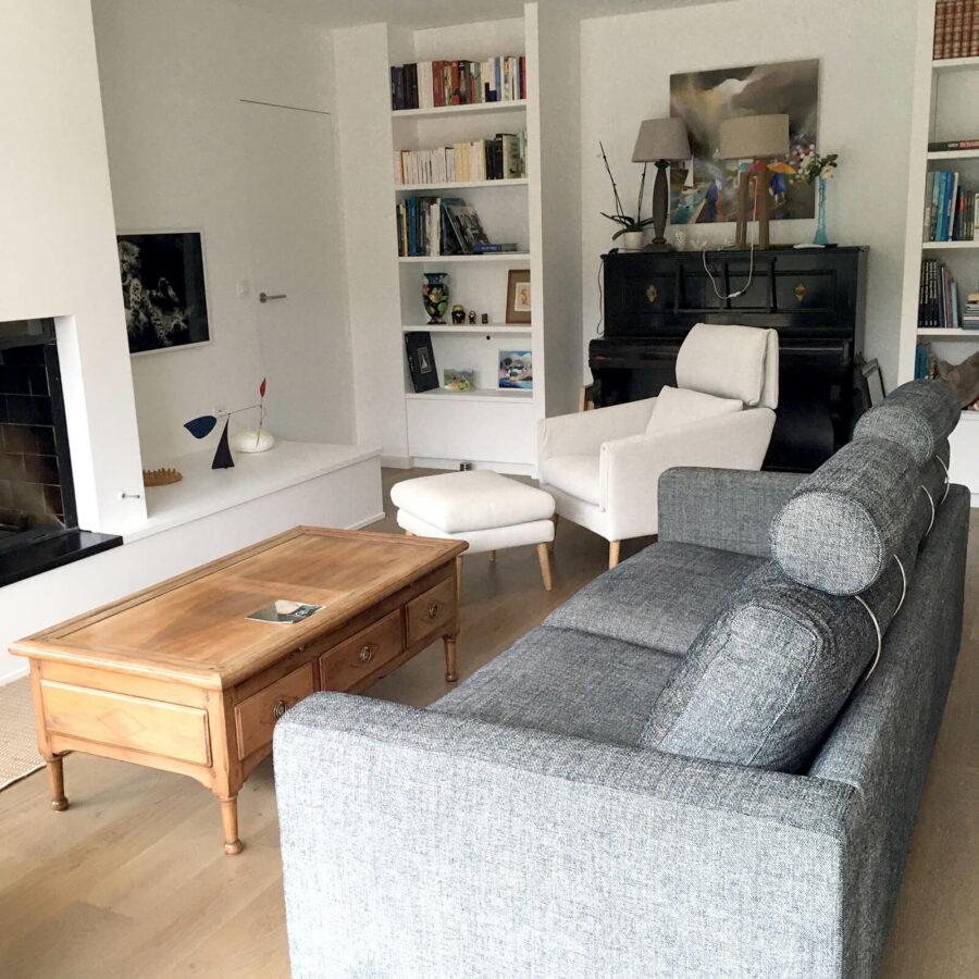 Aménagement d'un espace salon avec un fauteuil et un canapé Sits